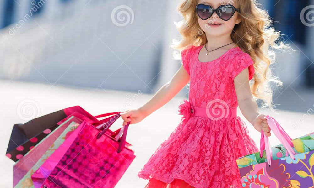 little-girl-shopping-bags-goes-to-store-cute-portrait-kid-child-dress-sunglasses-shoes-near-mall-having-62451031